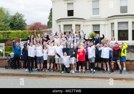 Birmingham,UK. 29 April 2018. Runners pose outside Michelin starred restaurant Simpsons in Edbgaston, Birmingham after completing the 'Finish for Matt' 3.7 mile run in memory of chef Matt Campbell who died after collapsing 3.7 miles from the end of last week's London Marathon.Credit:Nick Maslen/Alamy Live News - Stock Photo