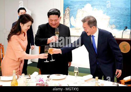 Moon Jae-In, Kim Jong-Un and Ri Sol-Ju, Apr 27, 2018 : South Korean President Moon Jae-In (R), North Korean leader Kim Jong-Un (C) and Kim's wife Ri Sol-Ju attend a banquet after the historic inter-Korean summit at the Peace House of the Panmunjom in the Demilitarized Zone (DMZ) separating the two Koreas in Paju, north of Seoul, South Korea. The historic summit ended on April 27 with calls for the complete denuclearization of the Korean Peninsula and an immediate halt to all hostile acts, local media reported. EDITORIAL USE ONLY (Photo by Inter-Korean Summit Press Corps/Pool/AFLO) (SOUTH KOREA - Stock Photo