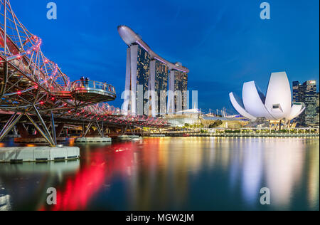 The Helix Bridge with The Marina Bay Sands, Singapore. - Stock Photo