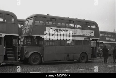 1960s, historical, broken double-decker buses lined-up in a yard awaiting to be scrapped, Manchester, England, UK. - Stock Photo