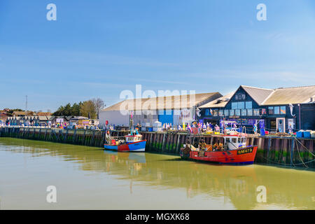 Fishing boats moored in Whistable Harbour, Kent - Stock Photo