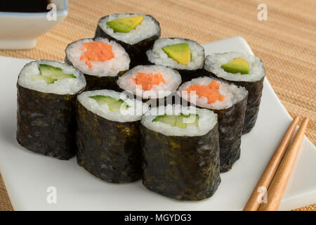 Traditional variety of Japanese vegetable sushi maki on a dish - Stock Photo