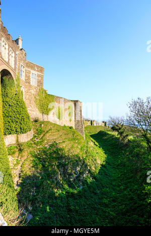 England, Dover castle. Outer Western curtain wall from the Constable's gate showing Queen Mary's tower and others in the distance. Bright sunshine. - Stock Photo