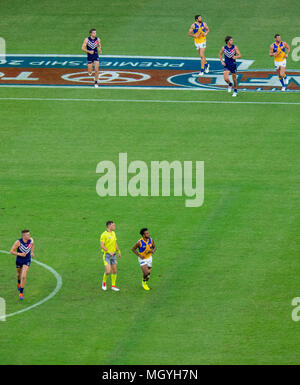 The first derby AFL, Australian Rules Football game between Fremantle Dockers and West Coast Eagles at Optus Stadium, Perth WA. - Stock Photo