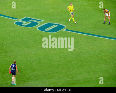 Nat Fyfe getting ready to kick the football in the first derby between Fremantle Dockers and West Coast Eagles at Optus Stadium, Perth, WA, Australia. - Stock Photo