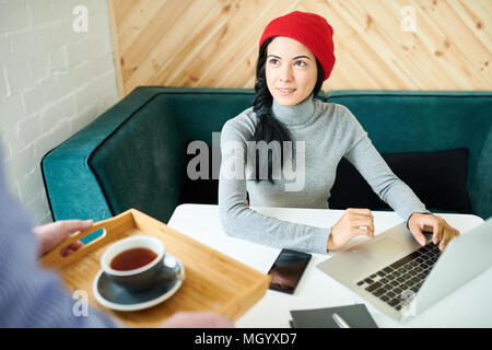 Pretty Woman Working in Cafe - Stock Photo