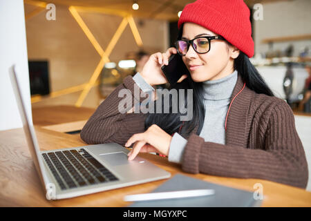 Trendy Woman Working in Cafe - Stock Photo