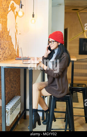 Contemporary Woman Working in Cafe - Stock Photo