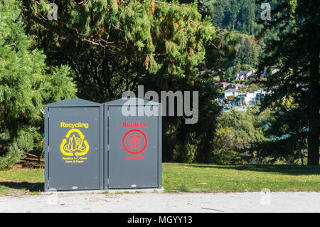 recycling bins for plastic glass and paper recycling also rubbish landfill disposal in queenstown gardens queenstown south island new zealand  nz - Stock Photo