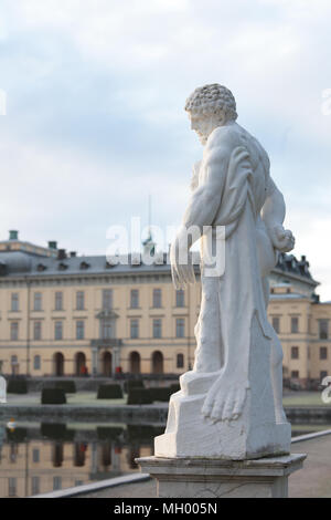 Classical statue against Drottningholm palace, Stockholm, Sweden - Stock Photo