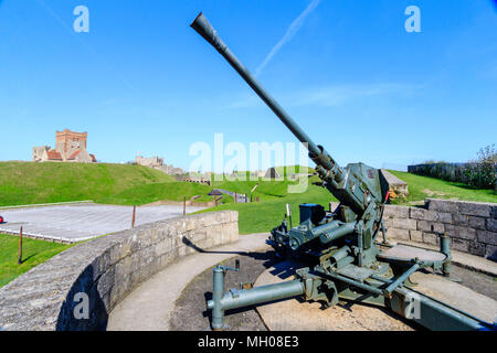 Dover castle, England. Eastern outer wall, with 40mm bofors anti-aircraft gun and emplacement. Bright sunshine, blue sky. - Stock Photo