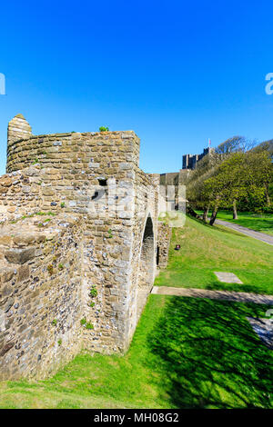 Dover castle, England. 13th century Hurst's Tower. Part of the western outer walls of the castle. Bright sunshine, blue sky. - Stock Photo