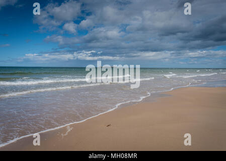 Farne Islands from Bamburgh Beach, Northumberland, UK. - Stock Photo