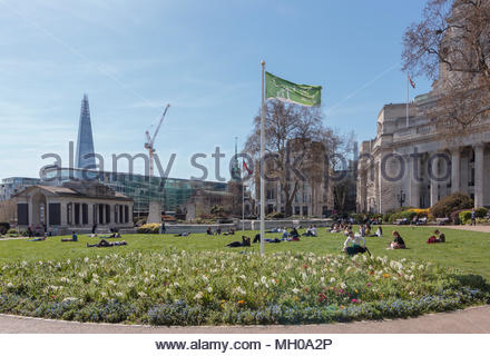 On a sunny spring day Trinity Square Gardens displayed with pride the Green Flag Award. - Stock Photo