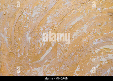 White and golden messy wall stucco texture background. Decorative wall paint.Abstract gold color painted on grunge rough surface of stucco concrete wall. - Stock Photo