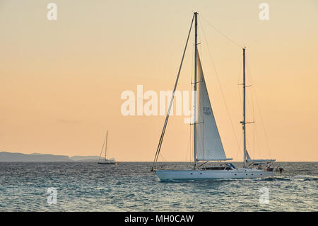 Sailing ship at sunset and Cabrera Archipelago in the background from Cap de Ses Salines cape in Majorca (Balearic Islands, Spain) - Stock Photo