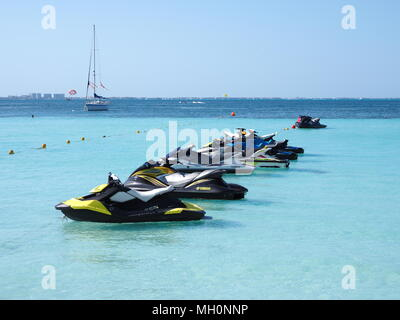 Beauty view of sandy beach panorama at bay of Caribbean Sea in Cancun city in Mexico with jet skis - Stock Photo