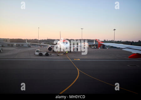 easyjet aircraft waiting to depart on the runway at bristol airport england uk - Stock Photo