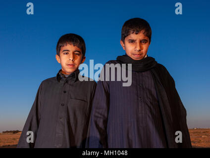 Portrait of two saudi boys, Al Madinah Province, Al-Ula, Saudi Arabia - Stock Photo