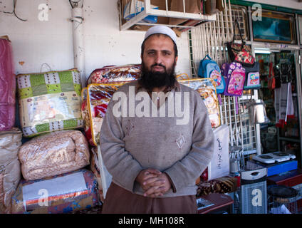 Foreign worker in a shop, Al Madinah Province, Al-Ula, Saudi Arabia - Stock Photo