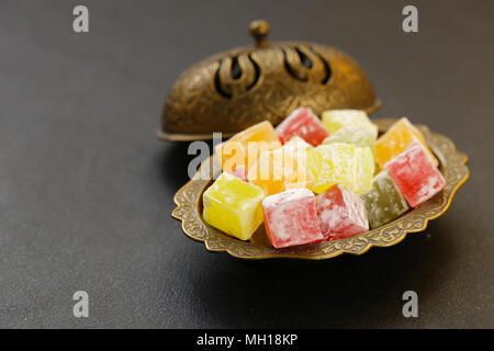 colorful sweet Turkish delight in the traditional dishes - Stock Photo