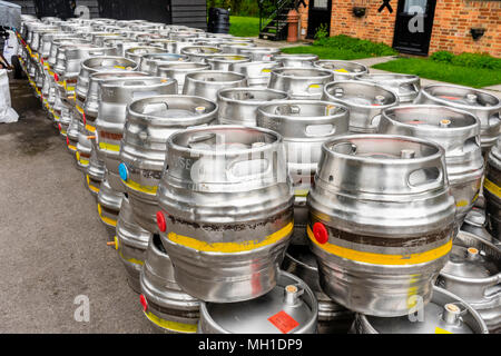 Rows of aluminium beer barrels outside the Flower Pots Brewery in the Hampshire village of Cheriton 2018, England, UK - Stock Photo
