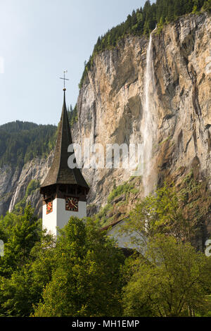 Waterfall in the Lauterbrunnen Valley in the Swiss Alps in Summertime - Stock Photo