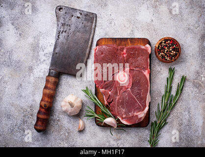 Lamb meat with rosemary, spices and cleaver.  - Stock Photo