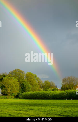 Rainbow over fields and countryside in Grantchester, Cambridge, Cambridgeshire, UK - Stock Photo