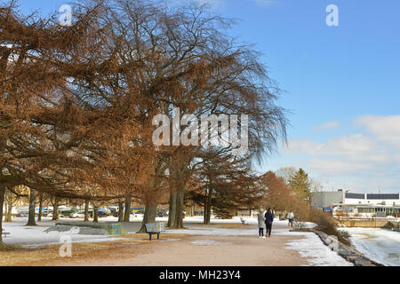 In park on embankment in spring - Stock Photo