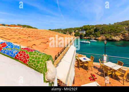 CALA FIGUERA BAY, MAJORCA ISLAND - APR 16, 2013: Tables on terrace of coastal restaurant located in beautiful village. Balearic islands are most visit - Stock Photo