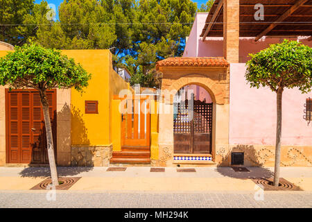 Doorways to typical colorful Spanish houses on street of Sant Elm town, Majorca island, Spain - Stock Photo