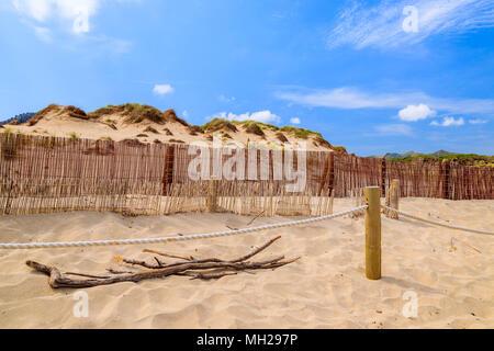 Sand dune and wind fence on Cala Mesquida beach, Majorca island, Spain - Stock Photo