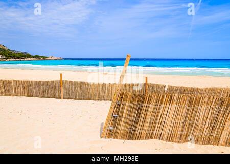 Winde fence on beach near Cala Mesquida, Majorca island, Spain - Stock Photo