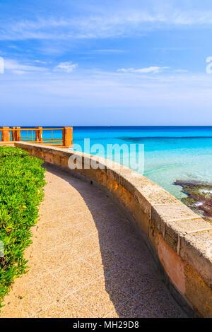 Coastal path along beautiful bay with beach, Majorca island, Spain - Stock Photo