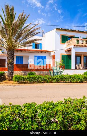 Typical colorful houses in small village on coast of Majorca island near Cala Ratjada, Spain - Stock Photo