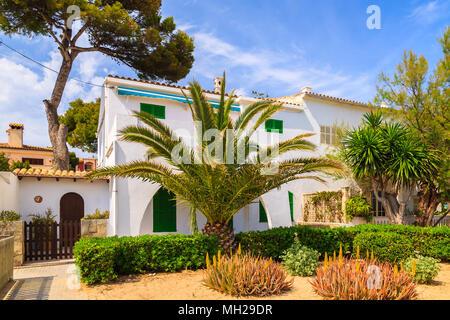 Typical houses in small village on coast of Majorca island near Cala Ratjada, Spain - Stock Photo