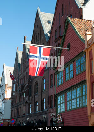 Norwegian flag flying from a building for Norwegian Constitution day, 17th May (syttende mai) - Stock Photo