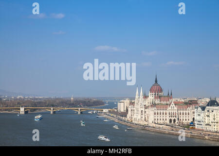 Panorama of Budapest with the Hungarian Parliament (orszaghaz) seen from the Budapest castle, the Danube river being in front with ships passing by  P - Stock Photo