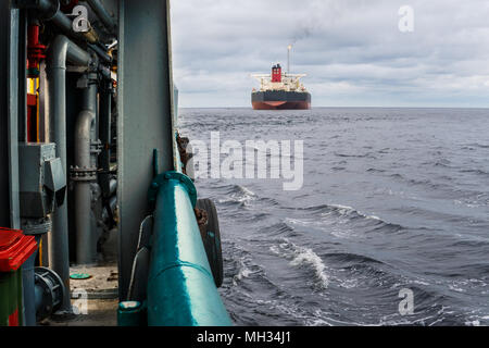 View from deck of AHTS ocean tug. Tanker vessel on background.