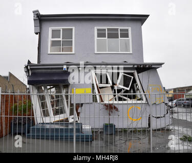 Christchurch, New Zealand - March 20, 2011: A house in the east of the city leans precariously after the 22 Februray 2011 earthquake. A red sticker ne - Stock Photo