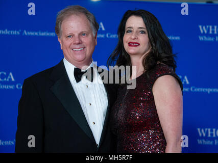 Washington, USA. 28th Apr, 2018. United States Senator Doug Jones (Democrat of Alabama) and his wife, Louise New, arrive for the 2018 White House Correspondents Association Annual Dinner at the Washington Hilton Hotel on Saturday, April 28, 2018. Credit: Ron Sachs/CNP (RESTRICTION: NO New York or New Jersey Newspapers or newspapers within a 75 mile radius of New York City) - NO WIRE SERVICE - Credit: Ron Sachs/Consolidated/dpa/Alamy Live News - Stock Photo