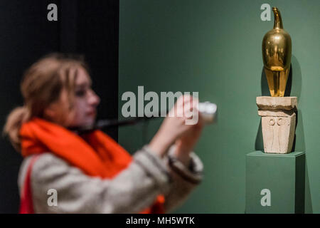 London, UK. 30th April, 2018. Maiastra by Constantin Brancusi - Shape of Light: 100 Years of Photography and Abstract Art - it features over 300 works by more than 100 artists, the exhibition explores the history of abstract photography side-by-side with iconic paintings and sculptures. It will be at the Tate Modern 2 May – 14 Oct 2018. Credit: Guy Bell/Alamy Live News - Stock Photo