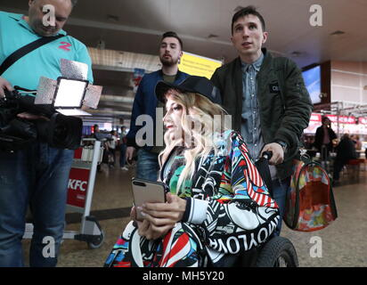 Russia. 30th Apr, 2018. MOSCOW, RUSSIA - APRIL 30, 2018: Singer Yulia Samoilova representing Russia and her husband, musician Alexei Taran (R) seen at Moscow's Sheremetyevo International Airport ahead of the departure of the Russian delegation for the 2018 Eurovision Song Contest scheduled to start on May 8 in Lisbon, Portugal. Anton Novoderezhkin/TASS Credit: ITAR-TASS News Agency/Alamy Live News - Stock Photo