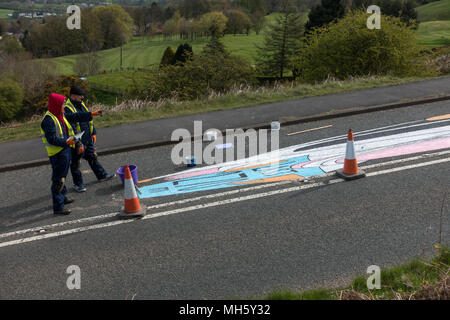 UK sport: Ilkley Moor, West Yorkshire, UK. 30th April 2018. Artists planning the next part of painting the Tour de Yorkshire's first summit finish on the Cow and Calf road ready for Friday's race.  It will be spanning both sides of the road. What's it going to be? (anamorphic land art) Rebecca Cole/Alamy Live News - Stock Photo