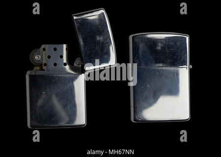 silver metal zippo lighter isolated on black - Stock Photo