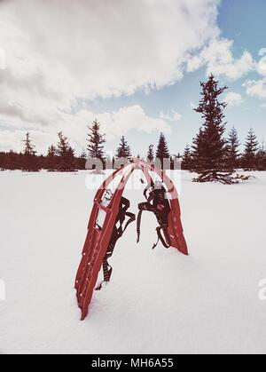 Snowshoes in snow. Winter trail over snowy hills and mountains. Winter walks with forests and mountains.  Outdoor winter activity and healthy lifestyl - Stock Photo