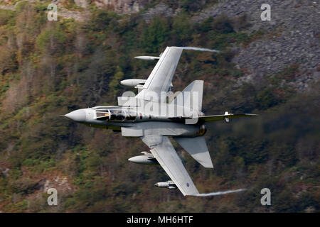 Royal Air Force Panavia Tornado GR4 aircraft  flying low level in the Welsh Mountains, Snowdonia National Park. Also called a Tonka, from a TV toy ad - Stock Photo