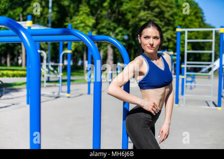 strong athletic girl on sport playground - Stock Photo