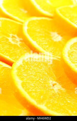 slices of fresh orange fruits as a food background texture - Stock Photo
